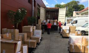 AGS loading boxes in truck for transport in Martinique.